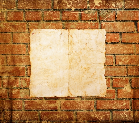Old paper on brick wall photo