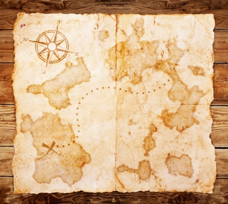 old treasure map, on wooden grunge background Stock Photo - 17162246