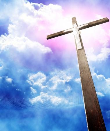 religious celebration: cross in sunrays against cloudy sky