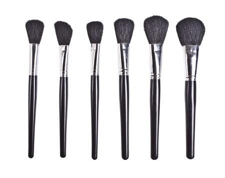 professional cosmetic brushes on white background photo