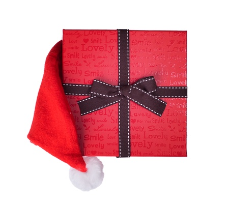 gift box with christmas hat on white background photo