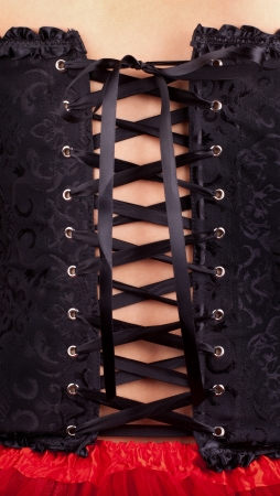 Close-up shot of woman in black corset Stock Photo
