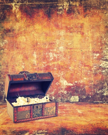 jewelry boxes: treasure chest with jewelry inside against grunge background