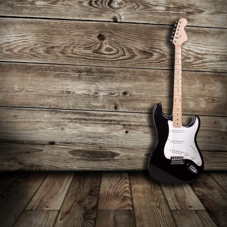木造の部屋のエレク トリック ギター
