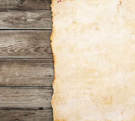 Old paper on the wood background photo