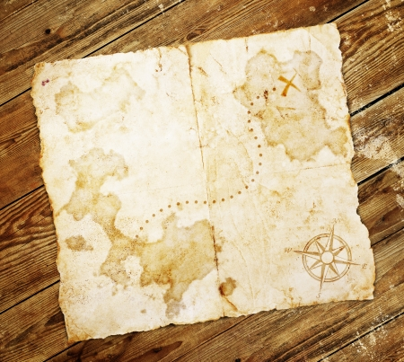 manuscript on parchment: old treasure map, on wooden grunge background