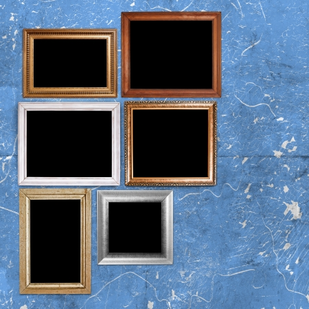 Random vintage frames in blue grunge room photo