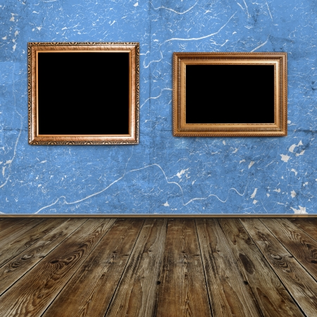 two golden frames in blue grunge room photo