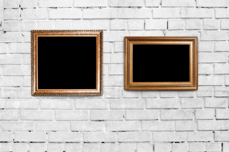 two golden frames on brick wall background photo