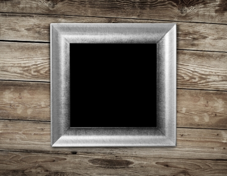 Vintage frame on wood background photo