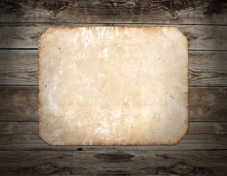 confines: Vintage photo frame on wood background