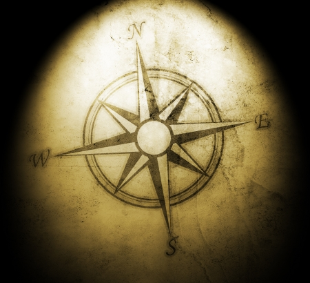 compass rose: Old compass on paper background