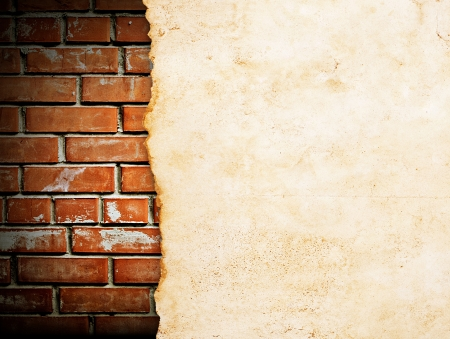 old paper on brickwall  photo