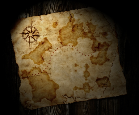 unknown age: old treasure map on wooden background