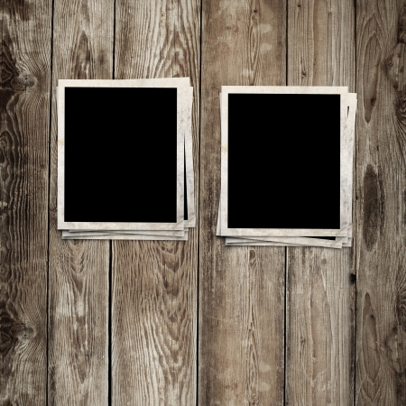 photo frames on wooden background photo