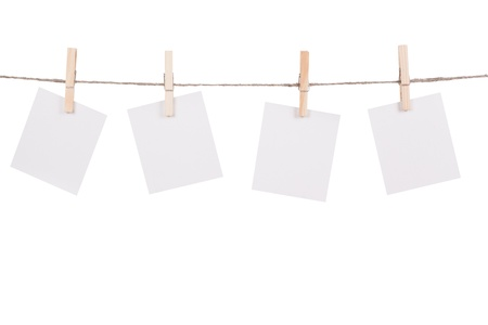 Blank instant photo hanging on the clothesline. Isolated on white background Stock Photo - 19956713