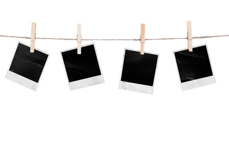 wooden insert: Blank instant photo hanging on the clothesline. Isolated on white background