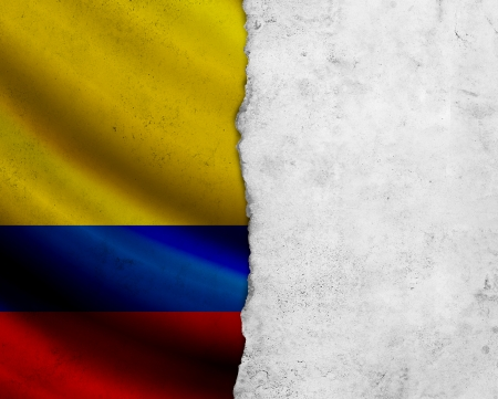 Grunge Colombia flag with paper frame photo