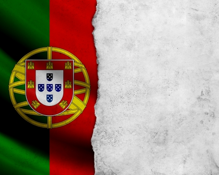 Grunge Portugal flag with paper frame photo