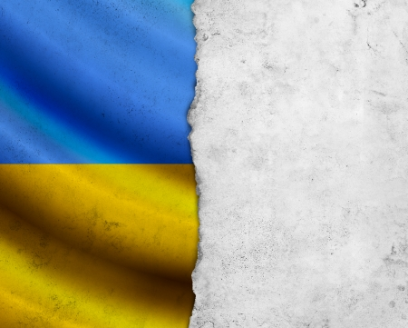 Grunge Ukraine flag with paper frame photo