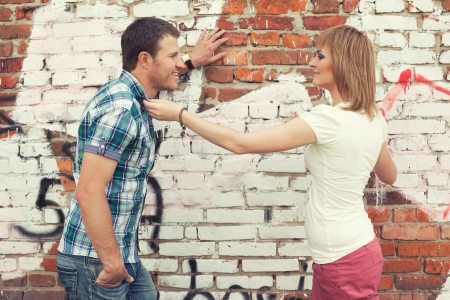 young couple against graffiti wall photo