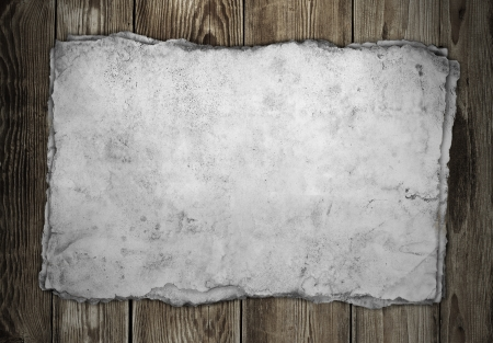 western pattern: Old paper on the wood background Stock Photo