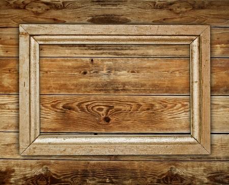 Vintage wooden frame on wood background Foto de archivo