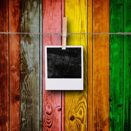 recollections: Blank Photos on Multicolored Wood Background