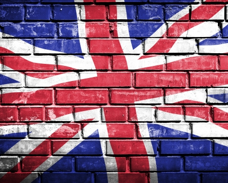 Grunge england flag on brick wall photo