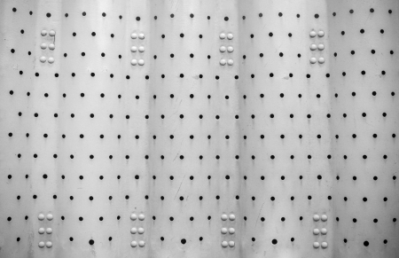 Metal background with holes  photo
