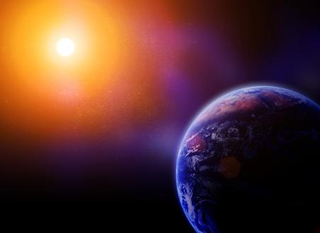 earth against the sun in space. Reklamní fotografie - 21222645