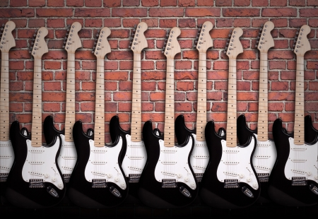 electric guitars on brick wall photo