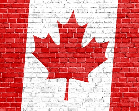 Grunge Canada flag on wall photo