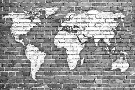 brick earth: world map on old brick wall  Stock Photo
