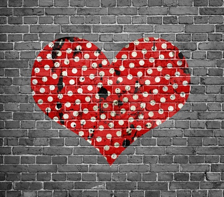 grunge heart: dotted grunge heart on brick wall Stock Photo
