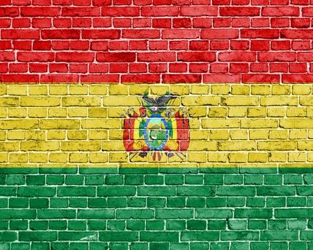 bandera de bolivia: Grunge bandera de Bolivia en la pared de ladrillo Foto de archivo