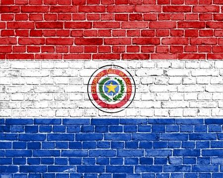 Paraguay flag: Grunge bandera Paraguay en la pared de ladrillo