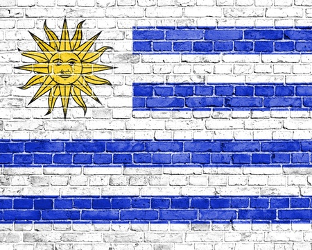 uruguay flag: Grunge Uruguay flag on brick wall Stock Photo