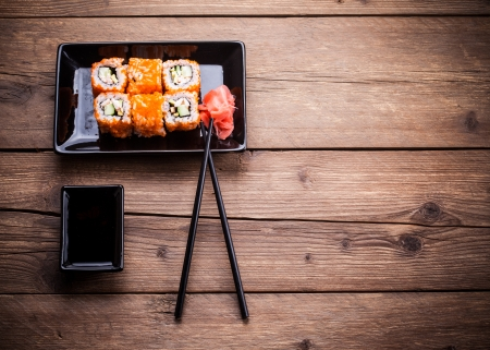 japanese foods: Maki Sushi set on wooden background Stock Photo