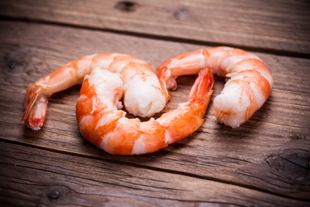 tiger shrimp: tiger shrimps on wooden background