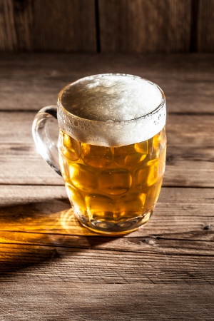 un bottled: Mug of beer on wooden background  Stock Photo