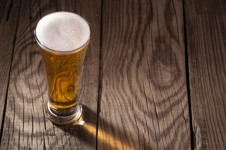 Mug of beer on wooden