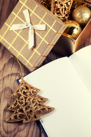 open book with christmas decoration on wooden  photo
