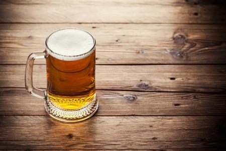 un bottled: Mug of beer on wooden table