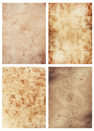 four old paper sheets on white background photo