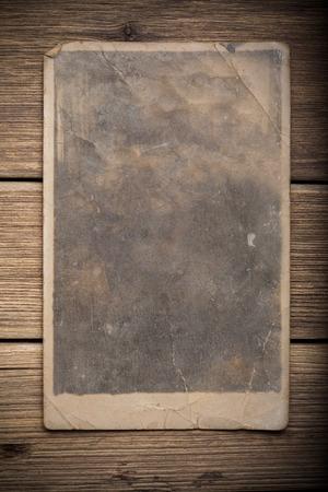Old photo on the wood background photo