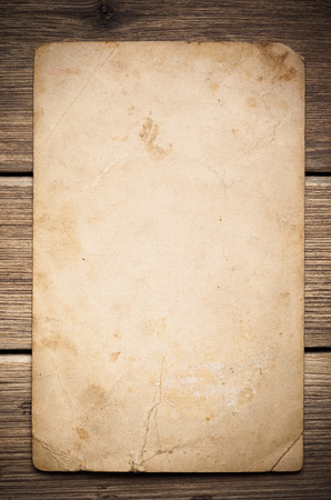 Old paper on the wood background Stockfoto