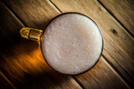 bleb: Mug of beer on wooden background