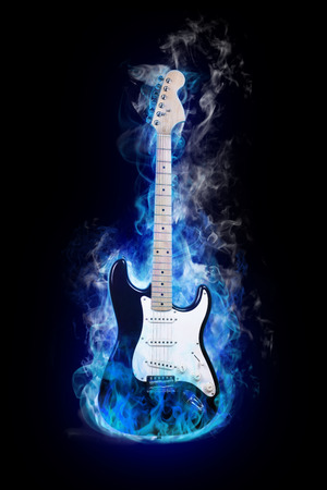 wood burning: electric guitar in flames on black background Stock Photo