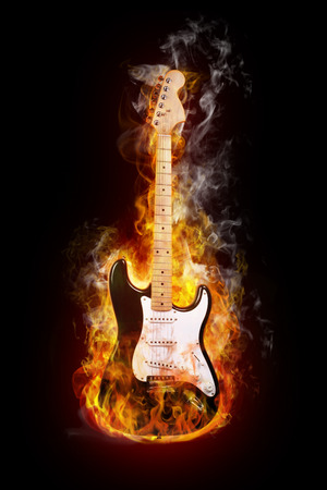 the blues: electric guitar in flames on black background Stock Photo